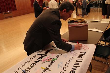 Dean Mike Wirth signs UA banner