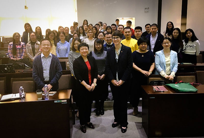 SIS Director Diane Kelly poses with faculty and students from Nankai University.