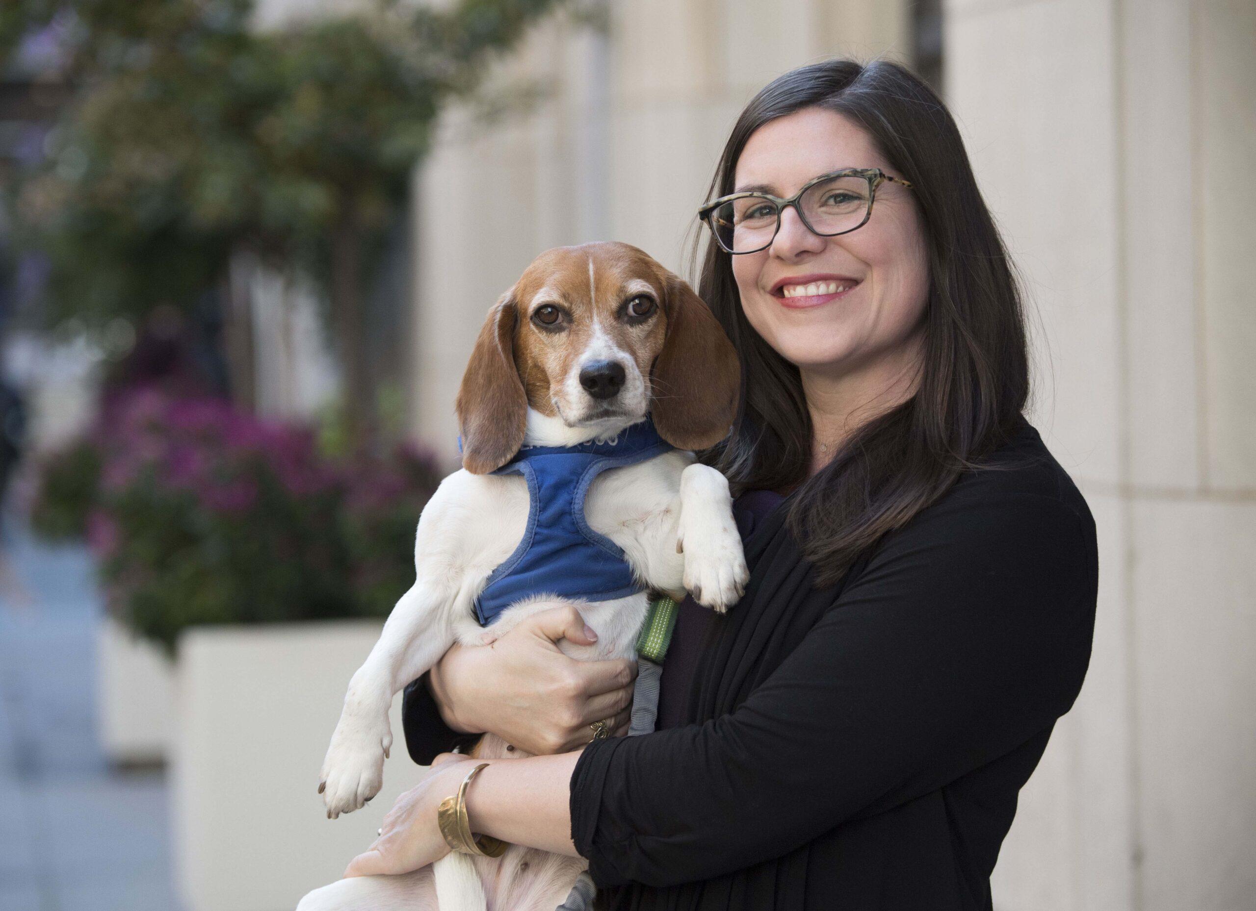 Ashley Maynor with service dog Cardamom