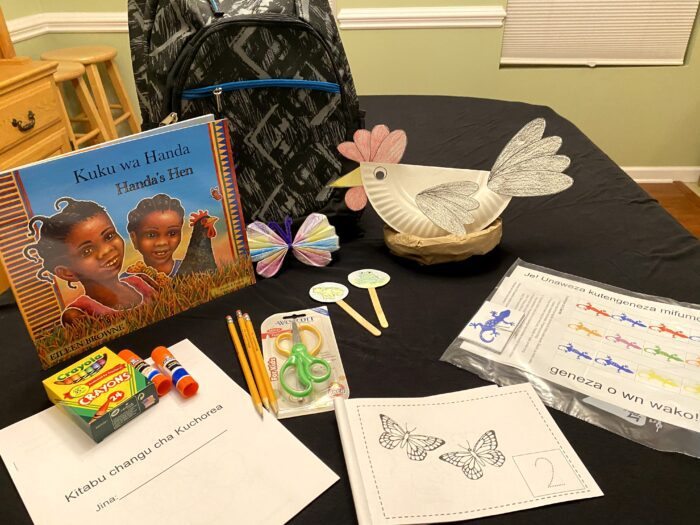 """A book, """"Handa's Hen"""" in Swahili sits with correlating activity supplies for children to do."""